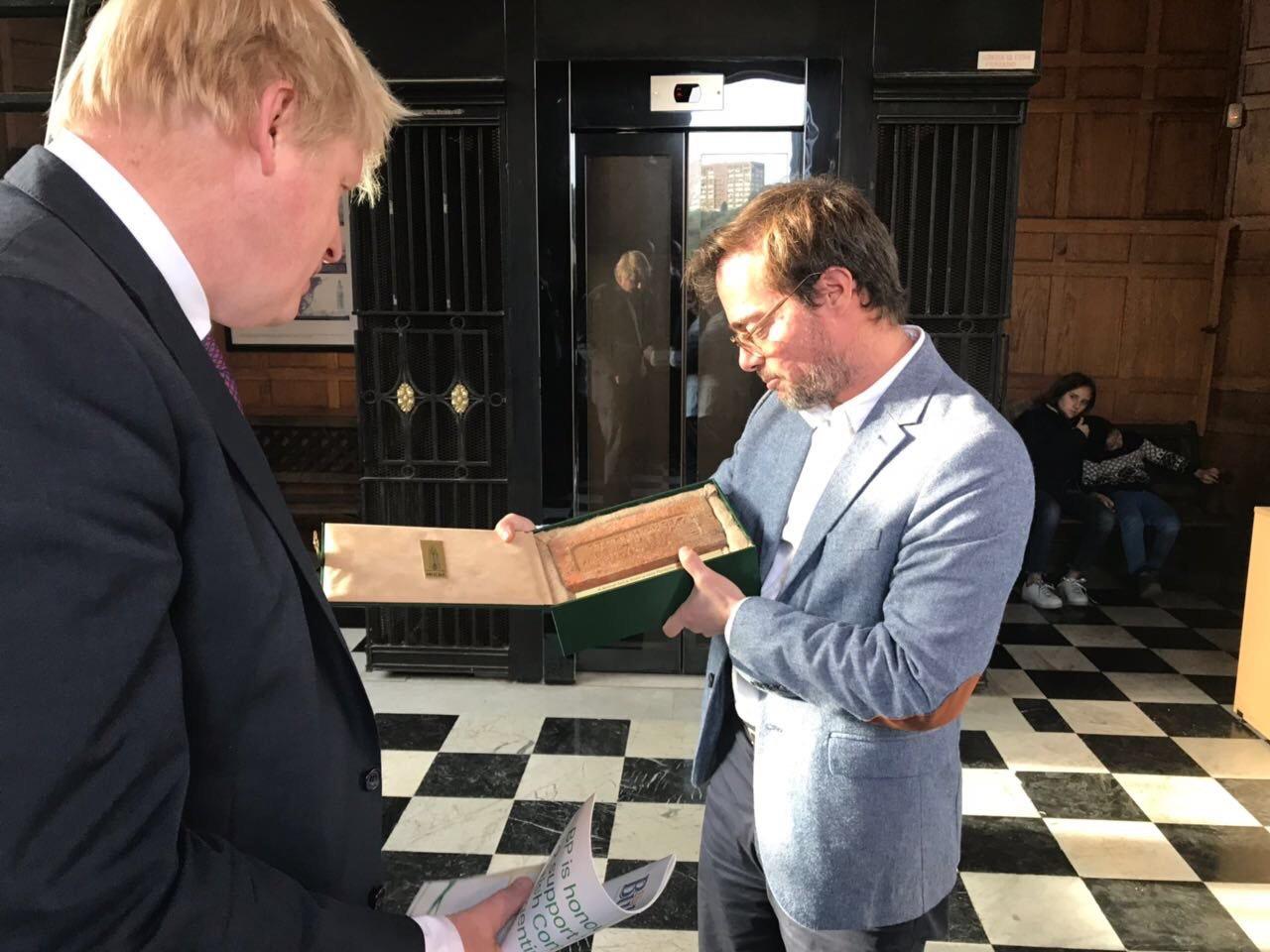 Boris Johnson receives the brick