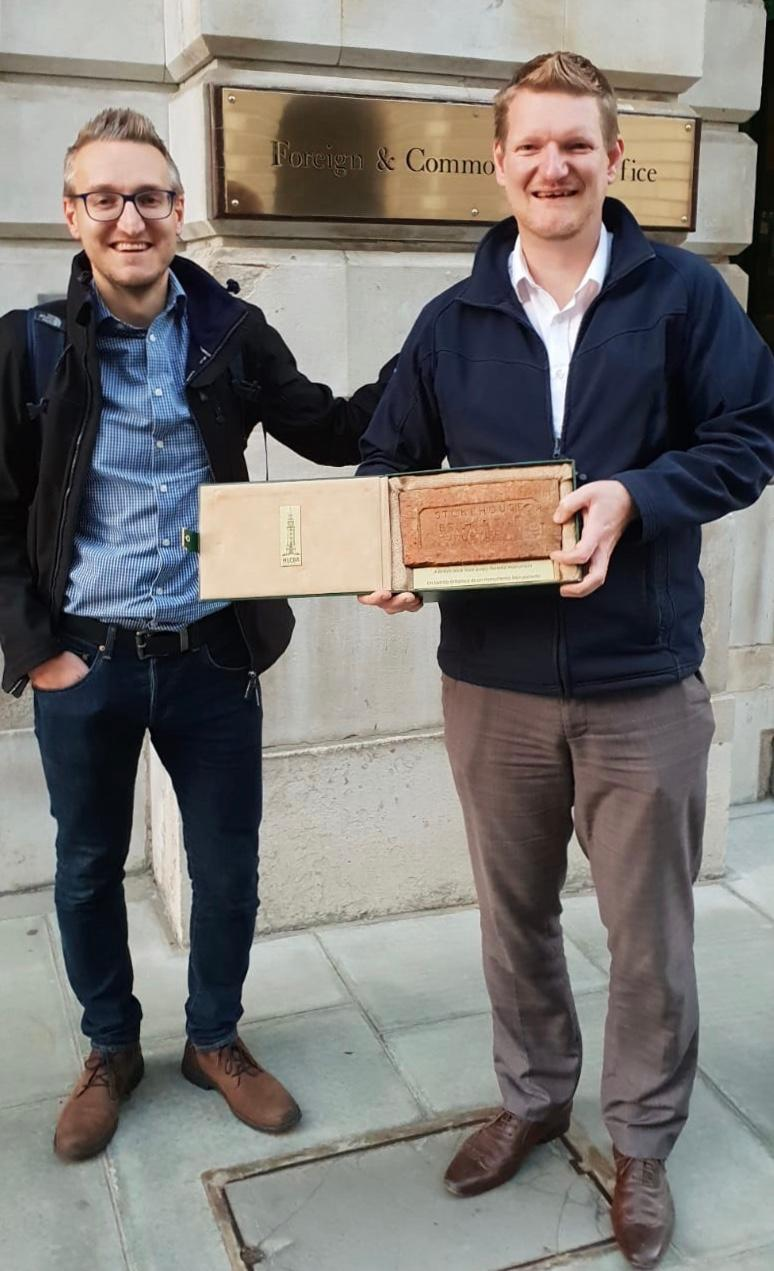 Aaron and Ryan collect the brick